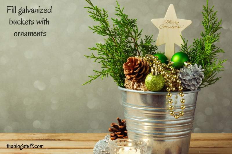 Galvanized bucket filled with Christmas decorations