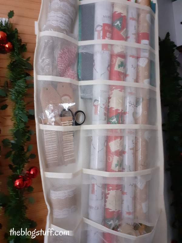 Using an over the door pocket organizer to store wrapping gift supplies
